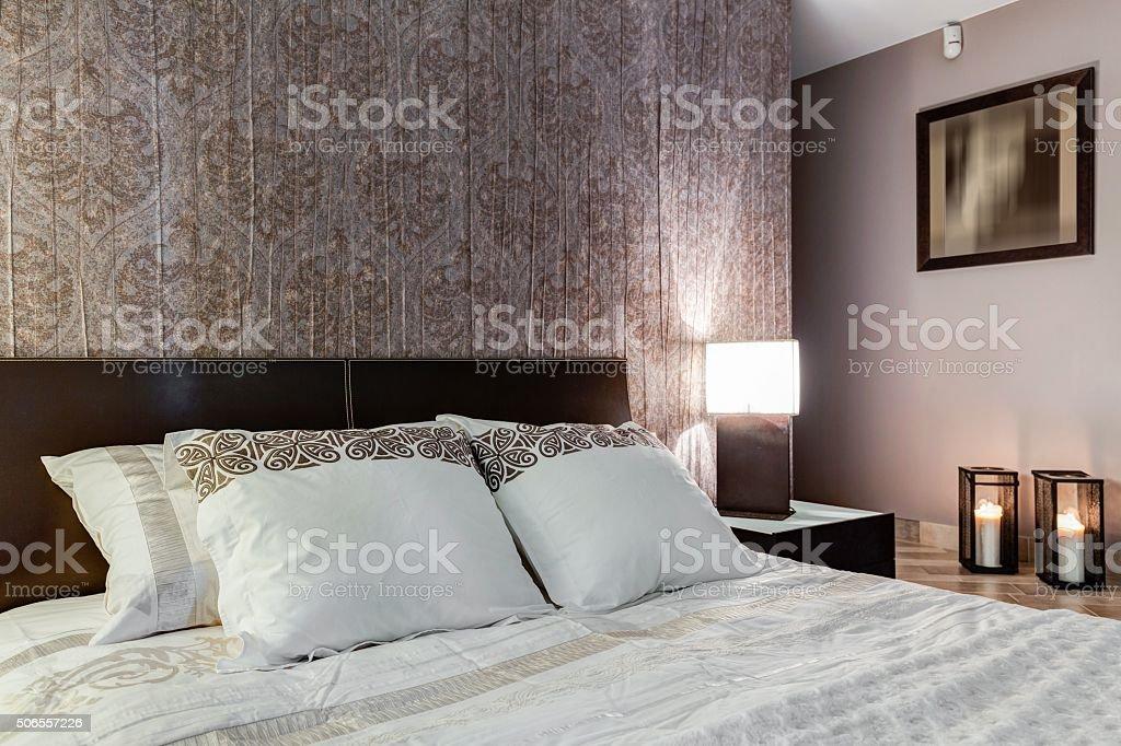 Posh bedroom with elegant walpaper stock photo