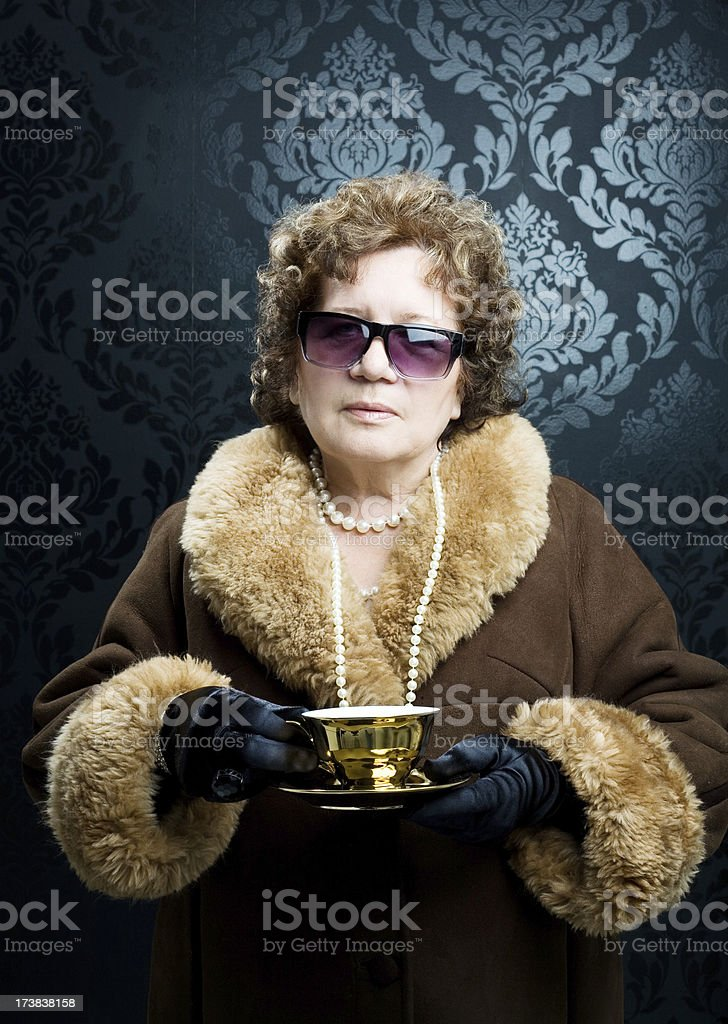 Posh Woman With Golden Tea Cup royalty-free stock photo