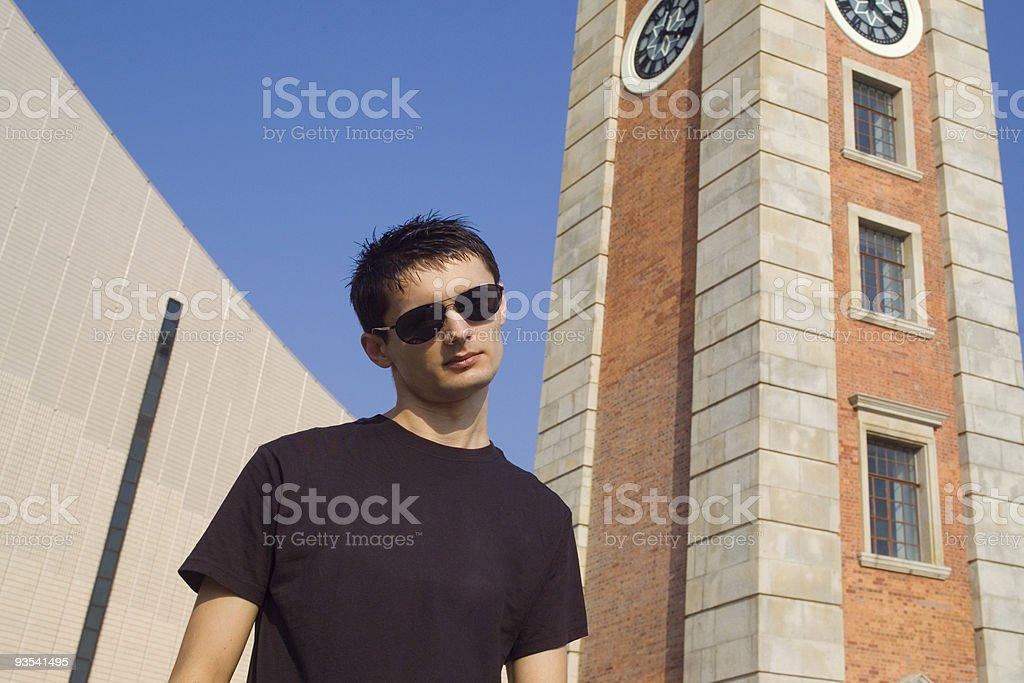 Posing by the Clock Tower Hong Kong stock photo