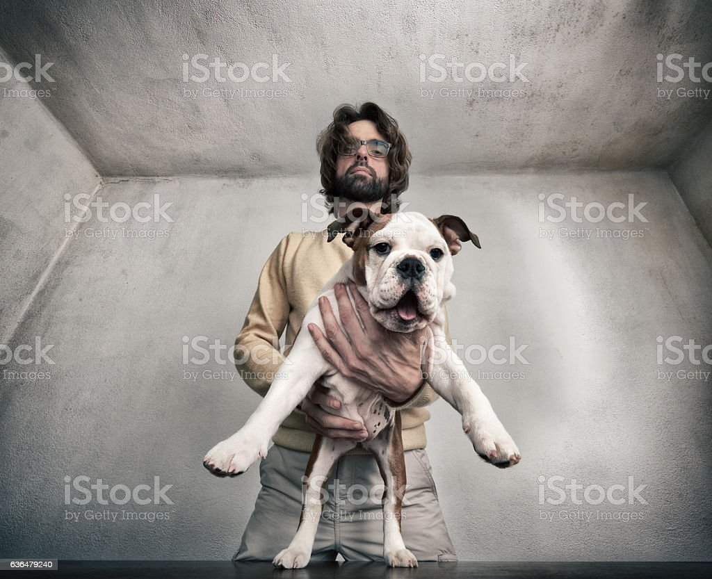 Posing for a portrait with a bulldog stock photo