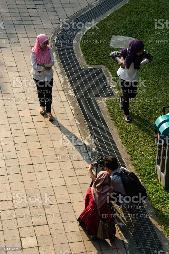 Posing in front of the Petronas Towers stock photo