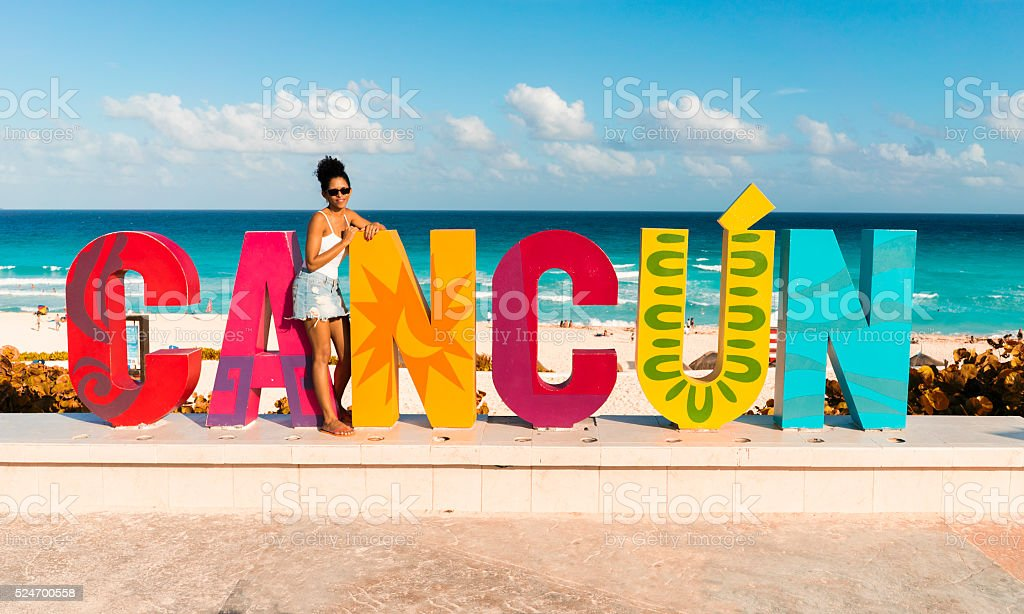 Posing tourist in Cancun, Mexico stock photo
