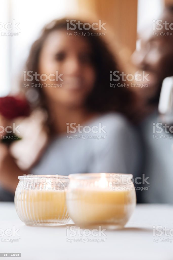 Positive African American couple sitting in the cafe stock photo
