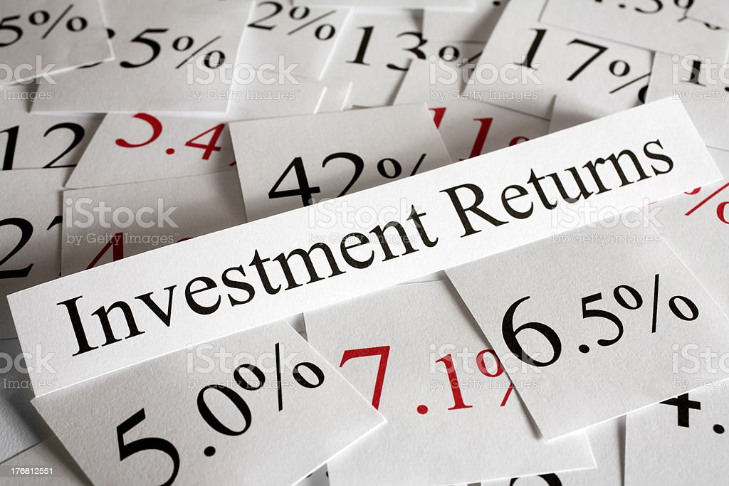 Positive and negative return on investment concept stock photo