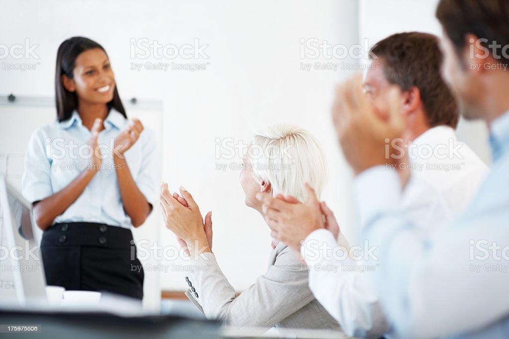 Positive business team applauding a good presentation stock photo
