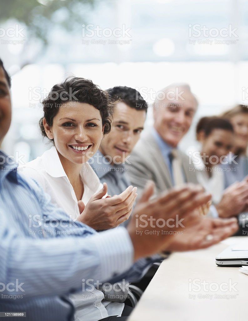 Positive business team applauding at a conference royalty-free stock photo