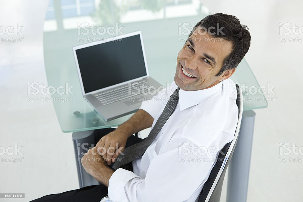 Positive businessman at workplace royalty-free stock photo