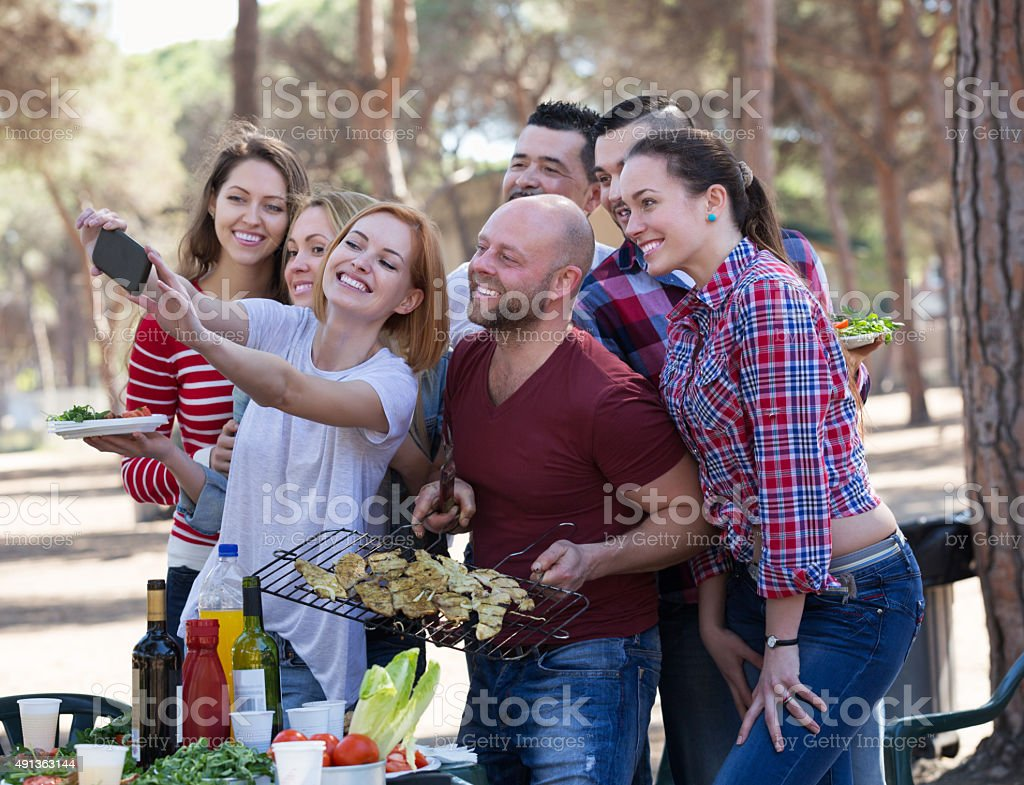 Positive colleagues making mutual photo stock photo