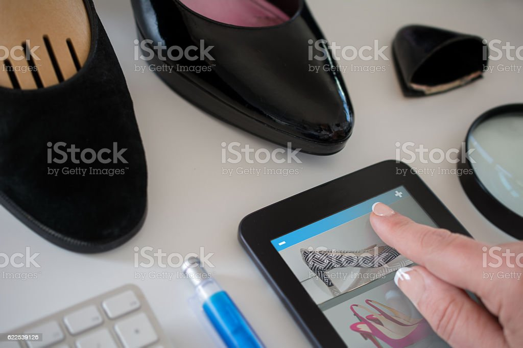 Positive consumer quality  test  shoes stock photo