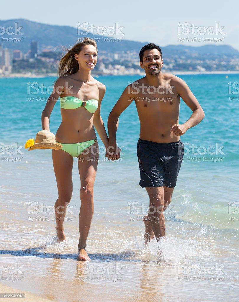 Positive couple running stock photo