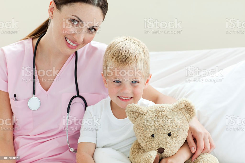 Positive cute boy holding a teddy bear royalty-free stock photo