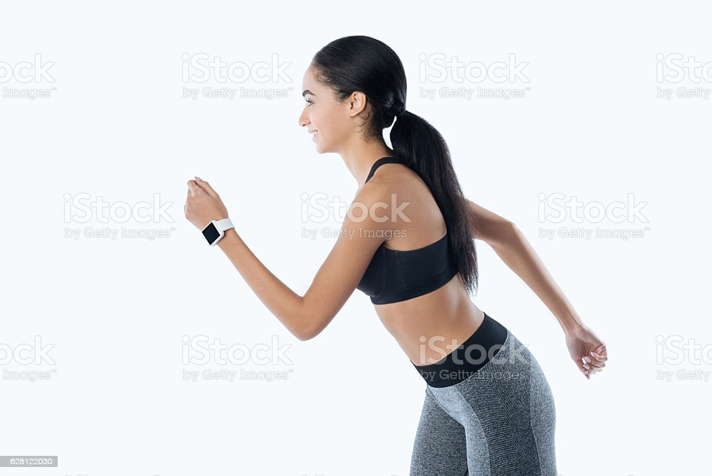 Positive delighted female while running stock photo