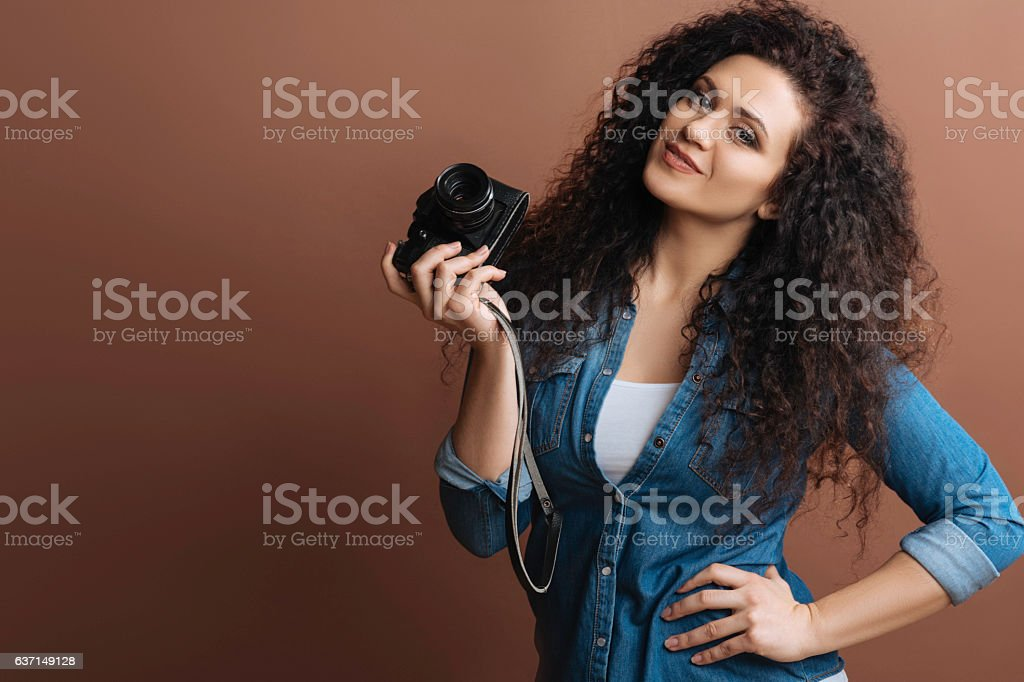 Positive delighted model posing with hand on the belt stock photo