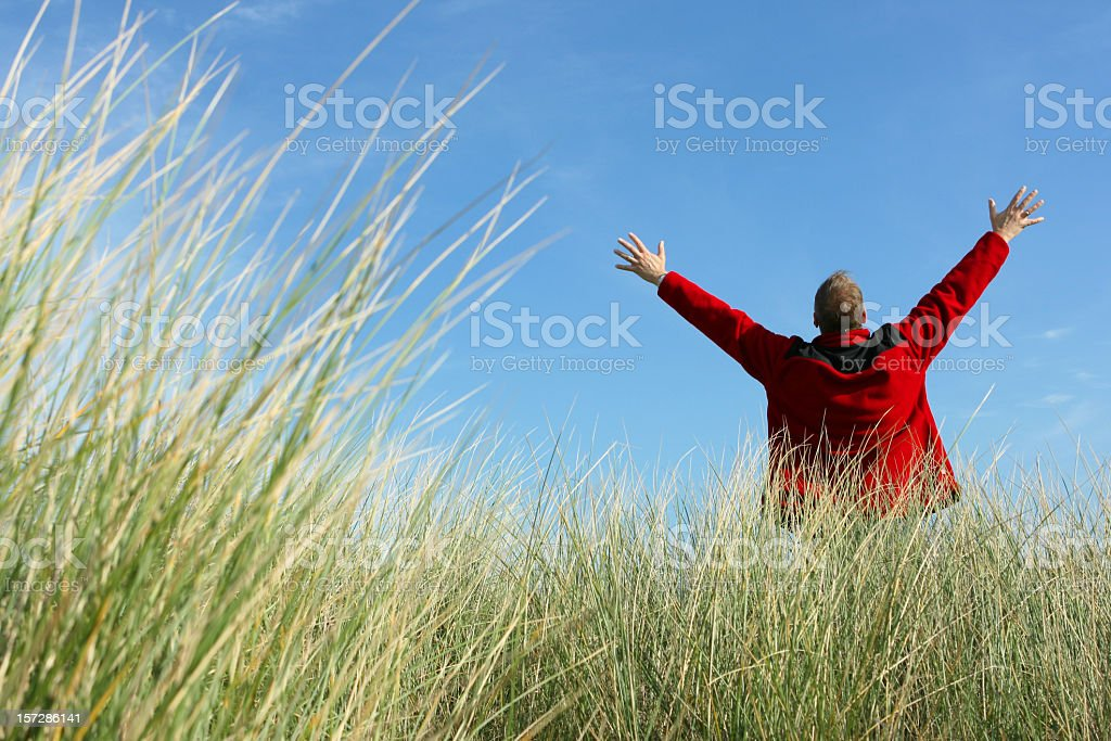 Positive Emotions - man jumping with hands in the air royalty-free stock photo