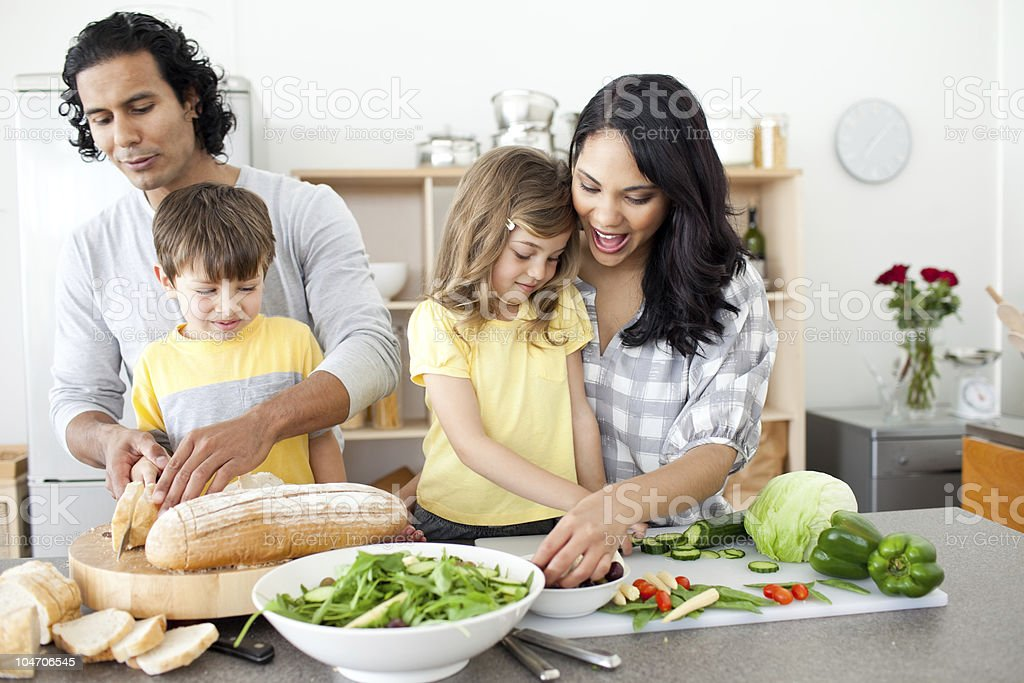 Positive family preparing lunch stock photo