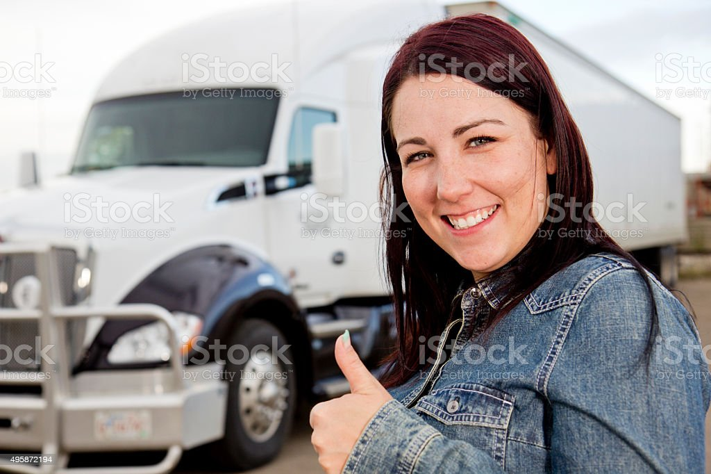 Positive Female  Driver and Semi Truck stock photo