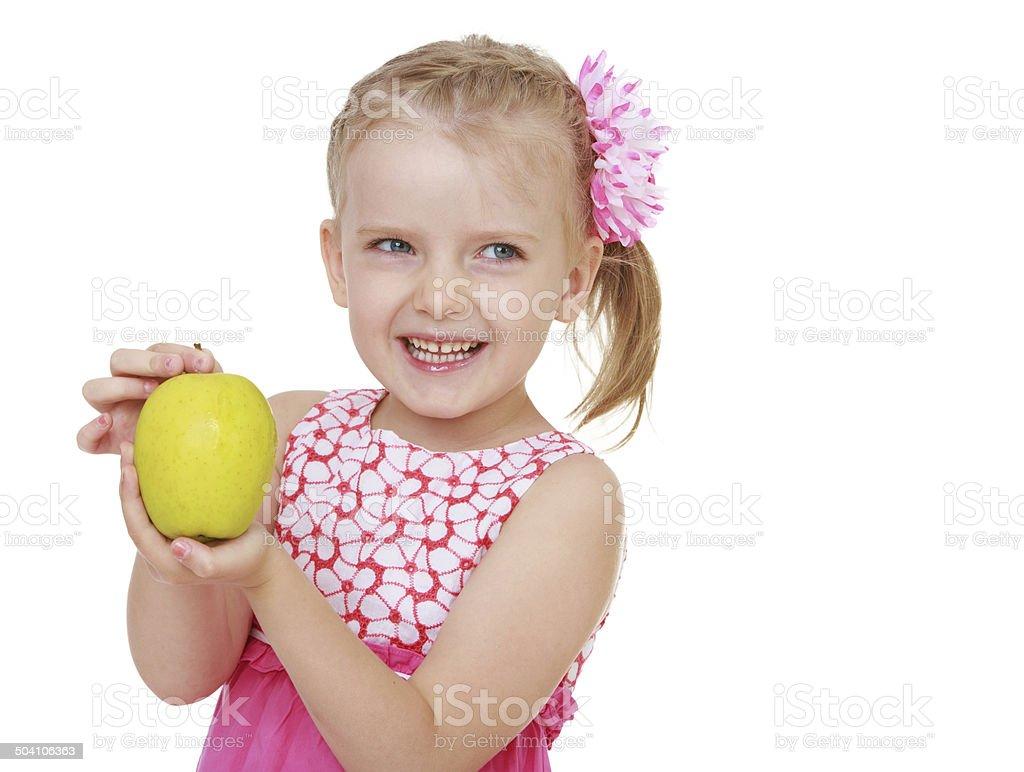 Positive jeune fille avec pomme verte photo libre de droits