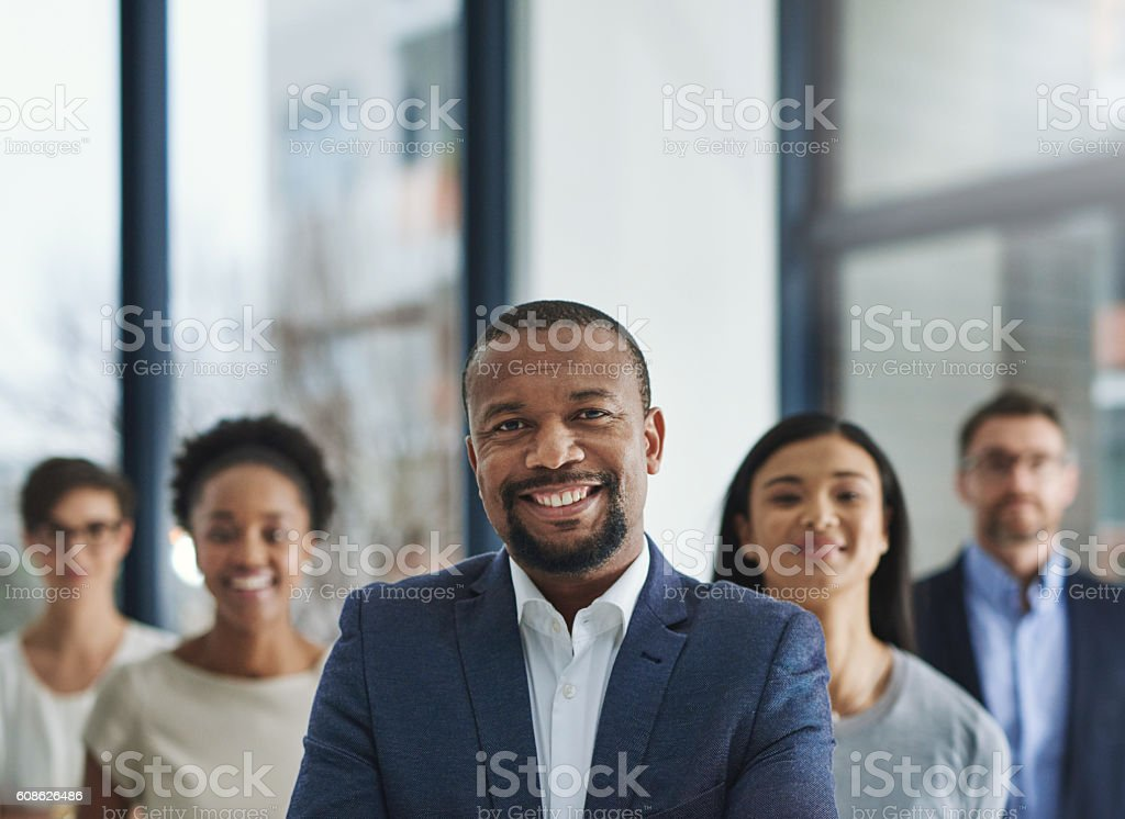 Positive leaders create productive teams stock photo