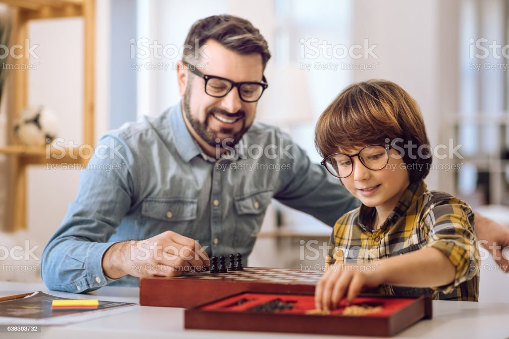 Positive males going to play chess stock photo
