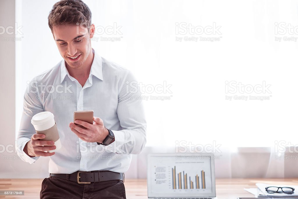 Positive man drinking coffee stock photo
