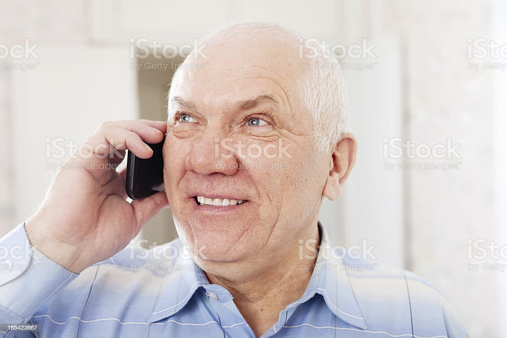 positive mature man speaks by phone royalty-free stock photo