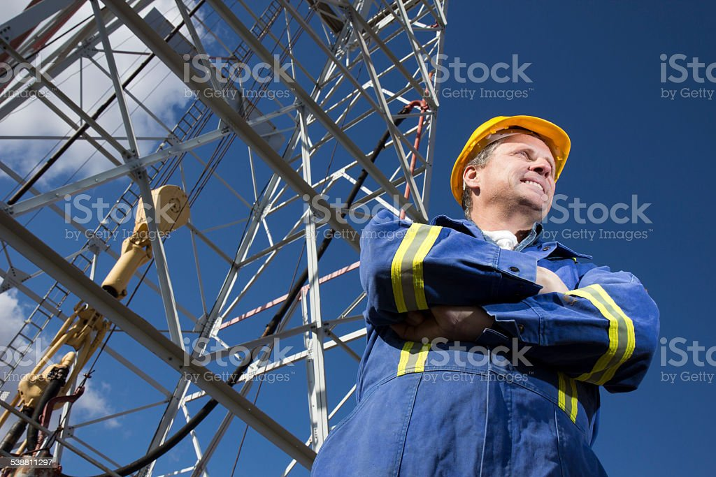 Positive Oil Engineer at a Drilling Well stock photo