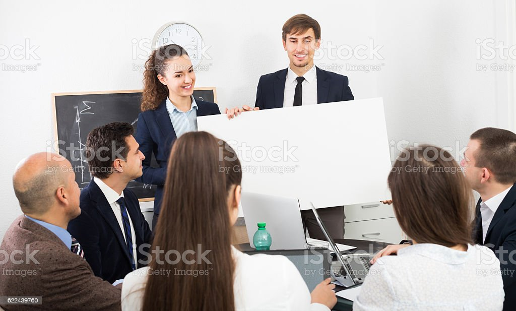 Positive people presenting new products plan stock photo