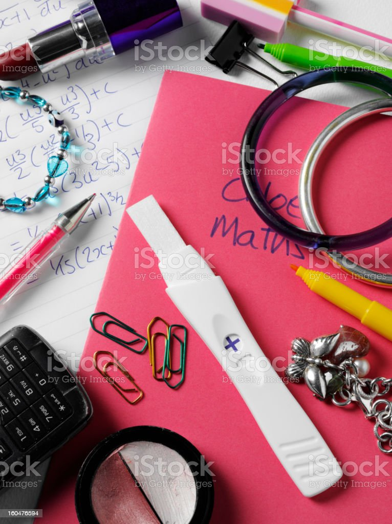 Positive Pregnancy Result on a School Desk royalty-free stock photo