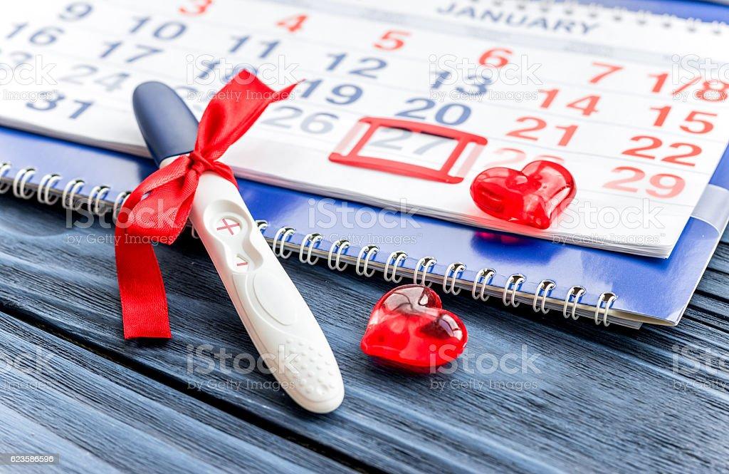 Positive pregnancy test with calendar stock photo