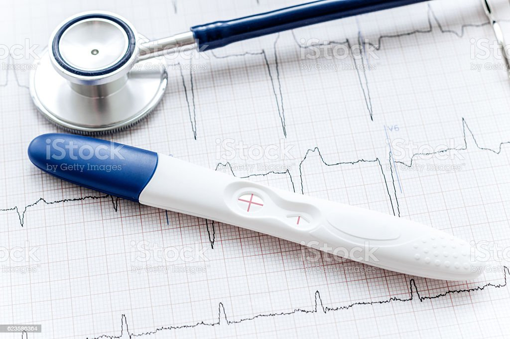 Positive pregnancy test with stethoscope stock photo
