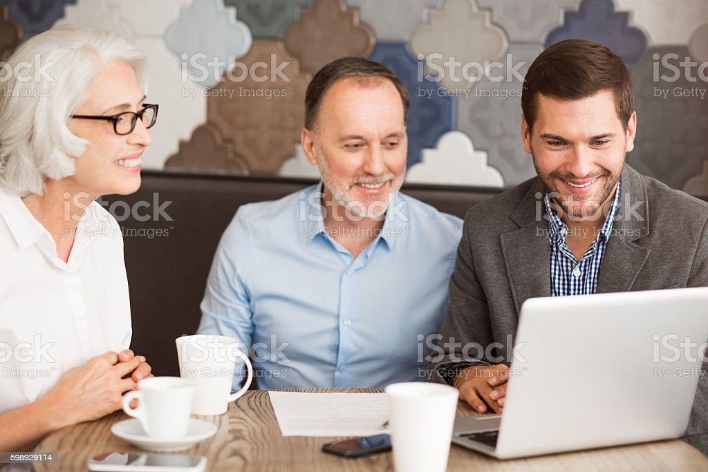 Positive sales manager working with his clients. stock photo
