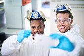 Positive scientists making selfie