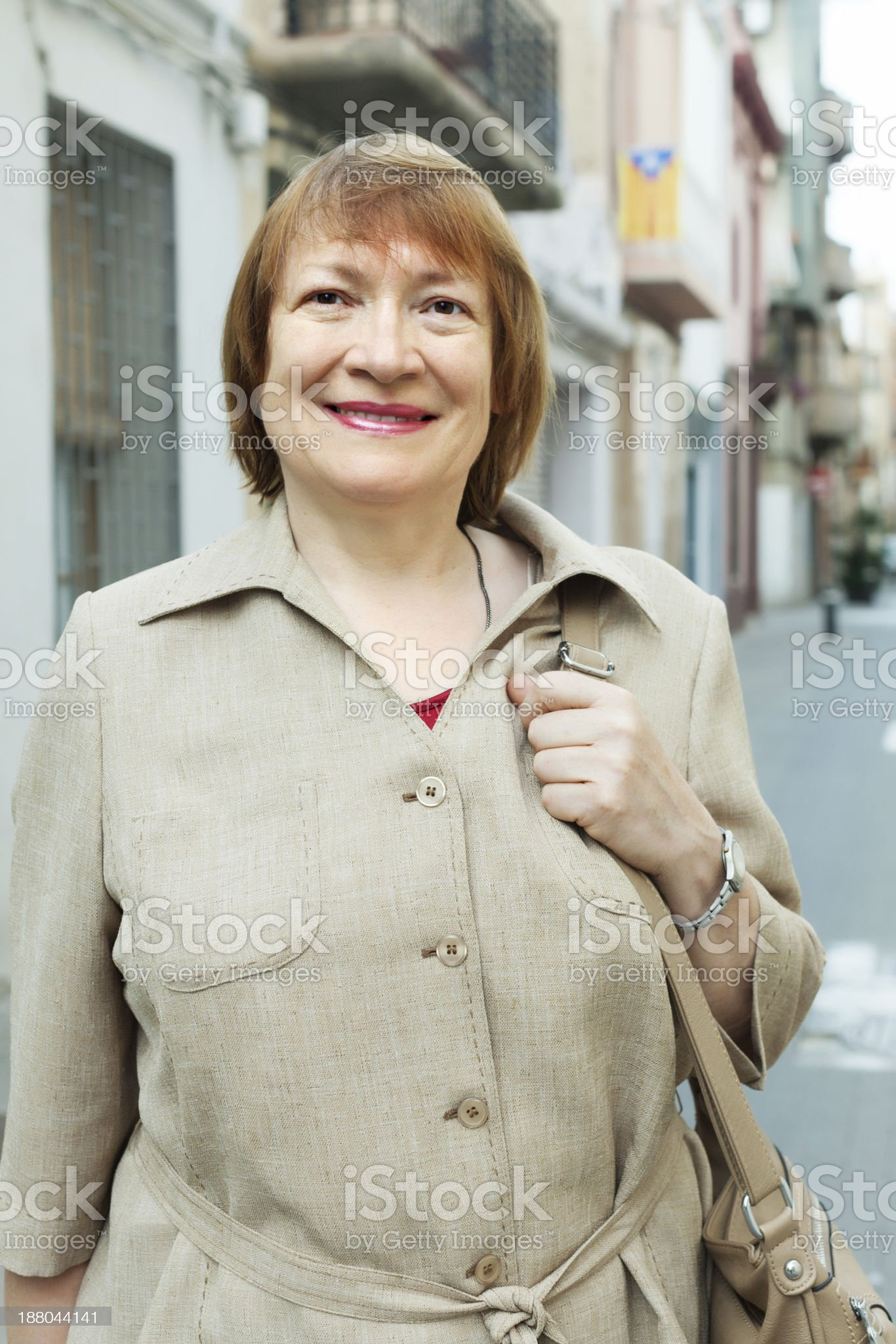 positive senior woman at european city street royalty-free stock photo