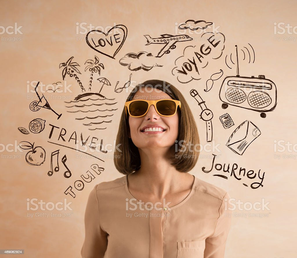 Positive smiling woman wearing sunglasses planning her vacation stock photo
