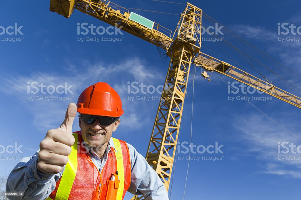 Positive Under a Crane royalty-free stock photo