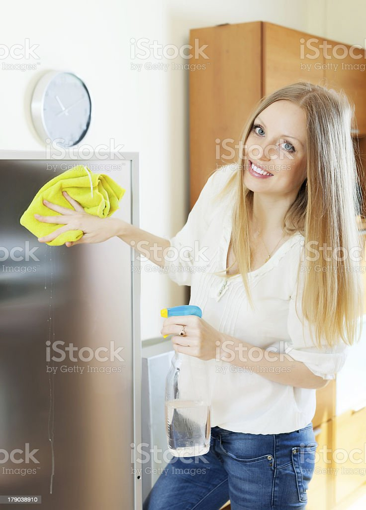 Positive woman cleaning  glass royalty-free stock photo