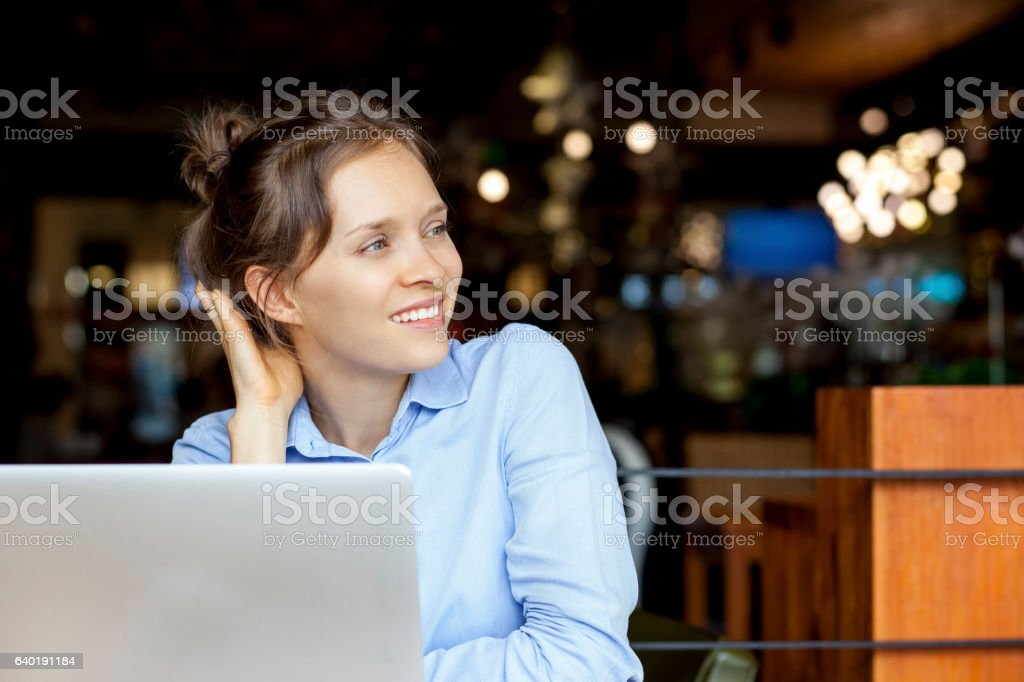 Positive woman thinking of business solution stock photo
