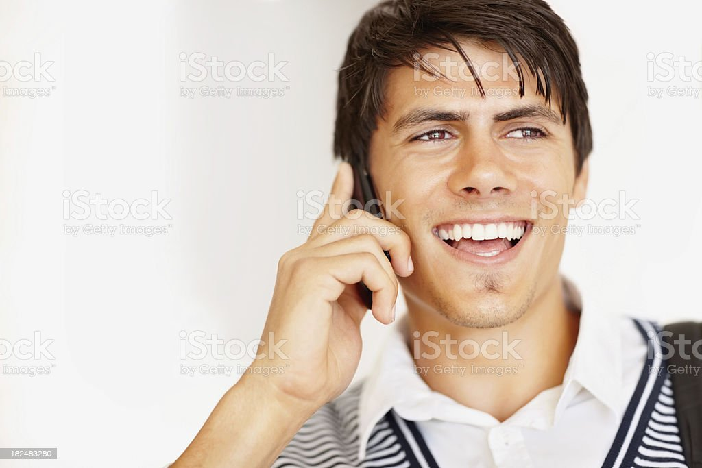 Positive young student enjoying a talk on cellphone royalty-free stock photo