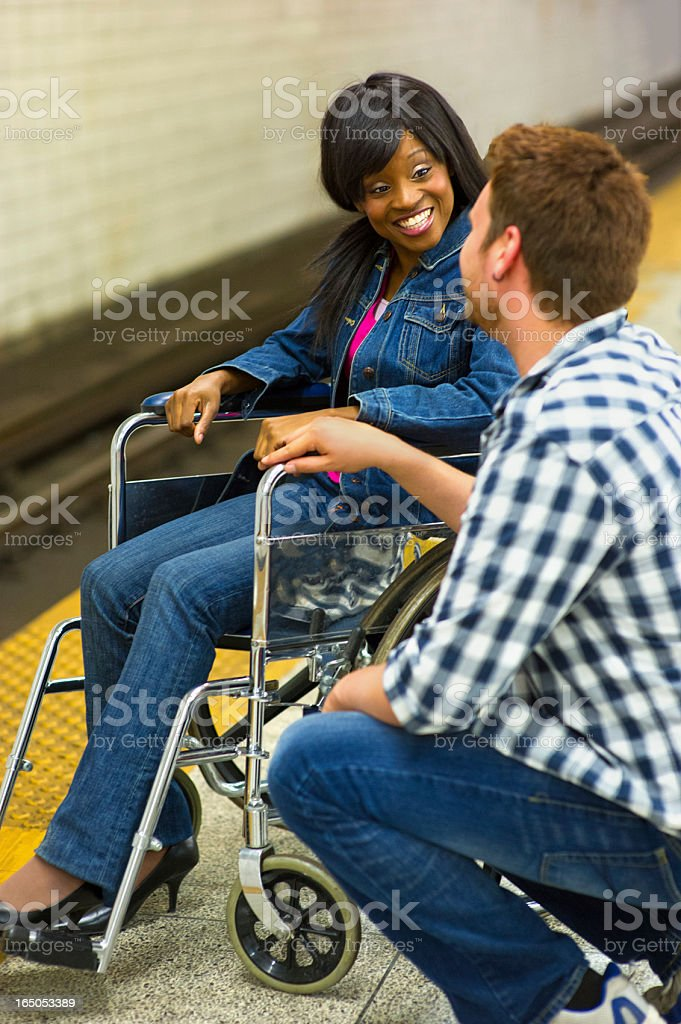 Positively Accessible: Young Couple on Subway Platform royalty-free stock photo