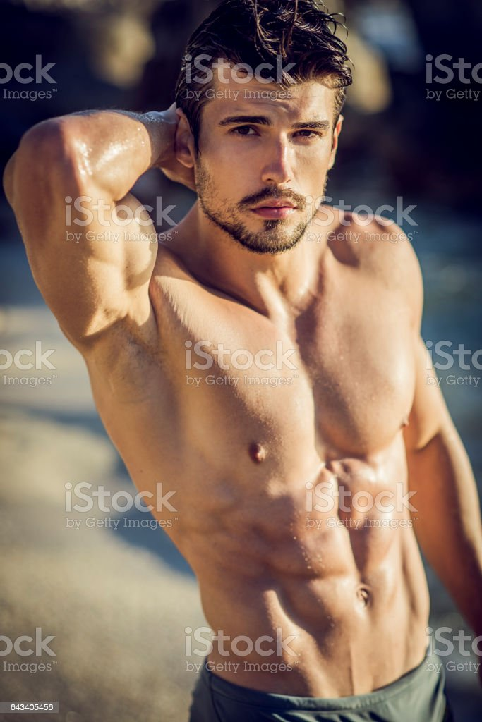 posrtrait of a handsome ripped young man stock photo