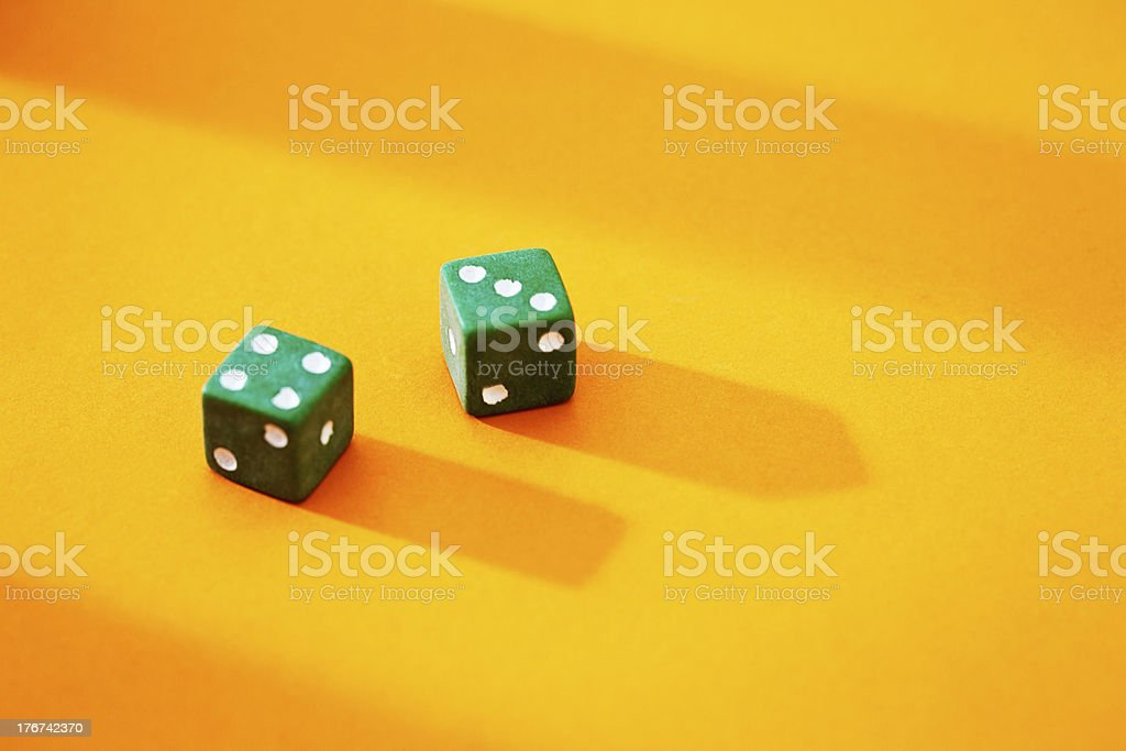 Possibly lucky throw of 7 from green dice royalty-free stock photo