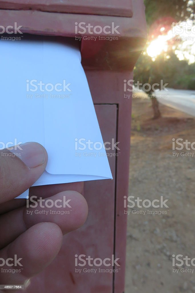 Post a letter in a mailbox stock photo