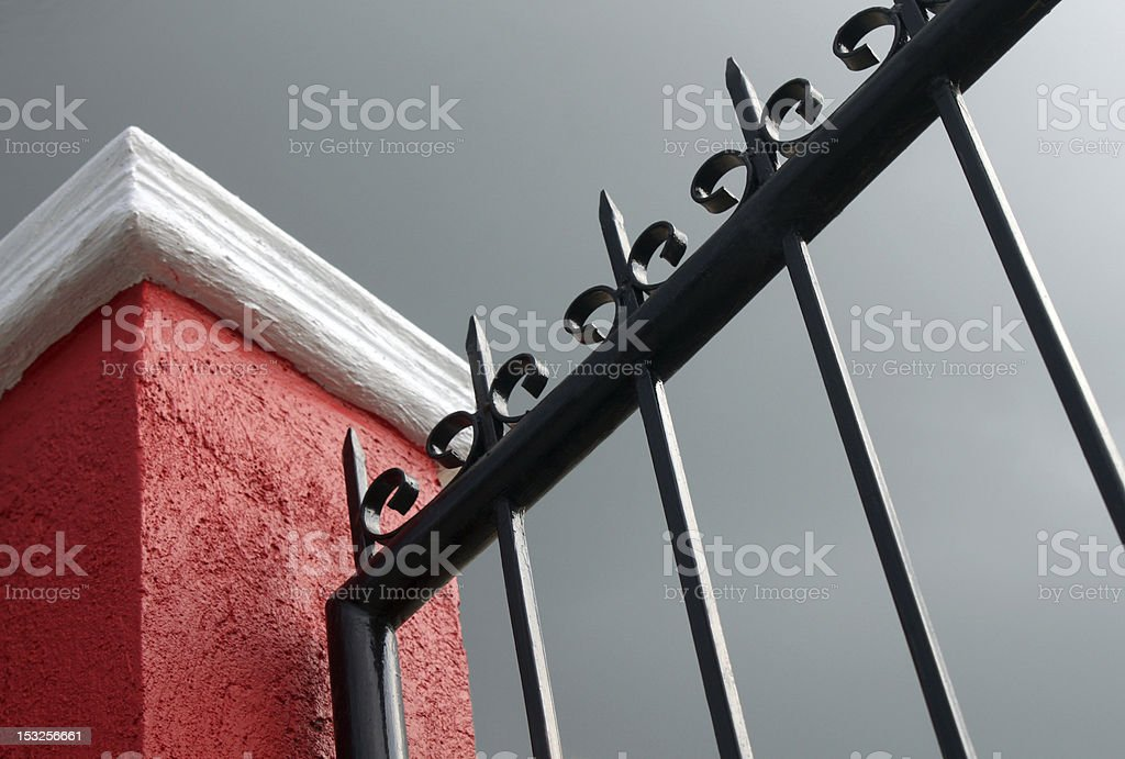 Post and Iron Fence stock photo