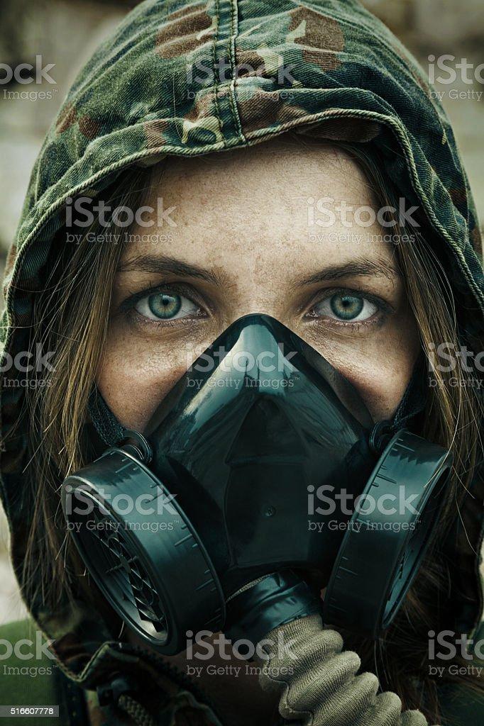 Post apocalypse female survivor stock photo