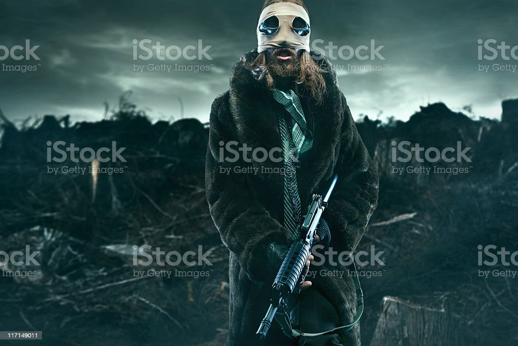 Post Apocalyptic Man in Wasteland with Weapon stock photo