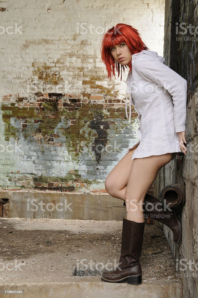 Post Apocalyptic Redhead in Ruins stock photo