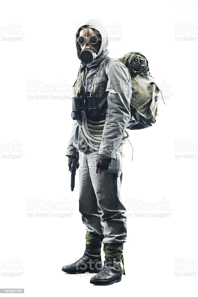Post apocalyptic survivor wearing a gas mask stock photo