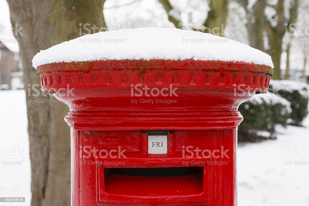 Post box with snow royalty-free stock photo