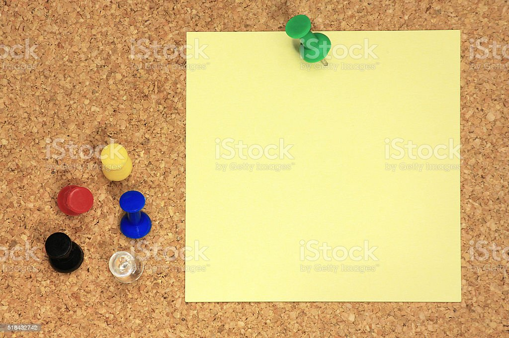 Post it and colorful thumbtacks on cork board stock photo