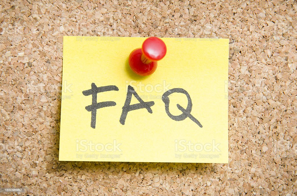 FAQ Post it note on a wood cork wall royalty-free stock photo